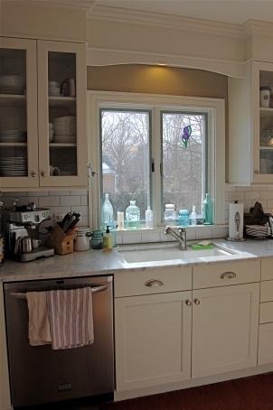 New cabinetry with with rain drop glass inserts.