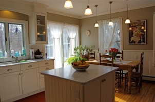 Original rock maple, hardwood floors were refinished throughout this eat in kitchen
