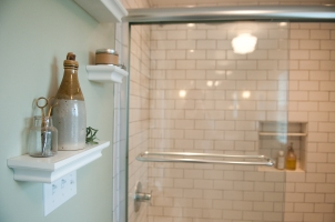 clear glass shower door and custom subway tiled shower surround.