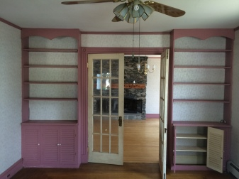 unattractive pink shelves and molding and a cracking ceiling.