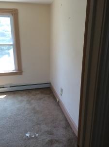 Old Carpet was removed to reveal original hardwood floors.