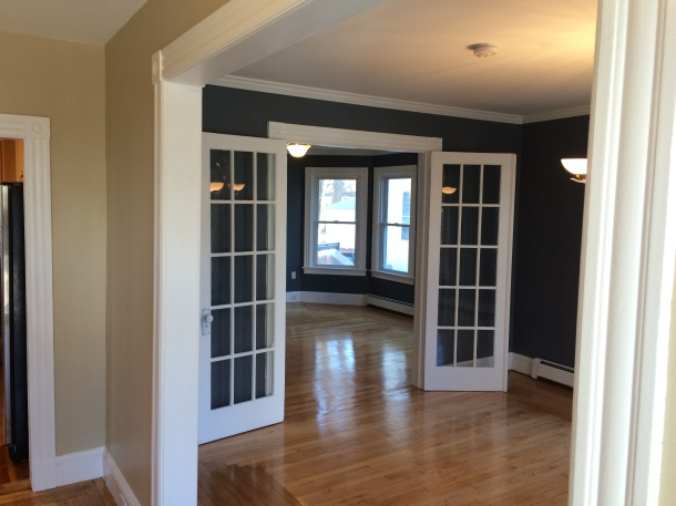 The old shelving was removed and the french doors were restored.