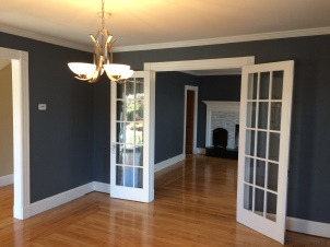 The ceiling in the dining room received new sheetrock and plaster to give it a smooth, seamless finish. Crown molding was added to finish the room off.