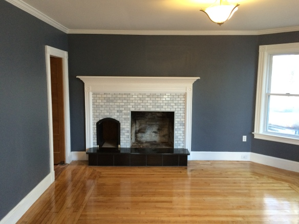 The massive old fire place was demolished and completely remodeled. The new Fireplace has a marble subway tile veneer and a solid granite hearth. the mantel was custom made to match elements of the molding throughout the house.