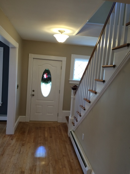 Entry-way (After Renovations)- New energy efficient front door opens and closes easily and works perfectly with the homes decor.