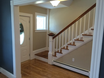 The staircase was striped and restored to its original beauty.