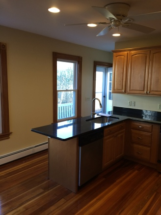 The old countertops were removed and new custom solid granite countertops where installed.