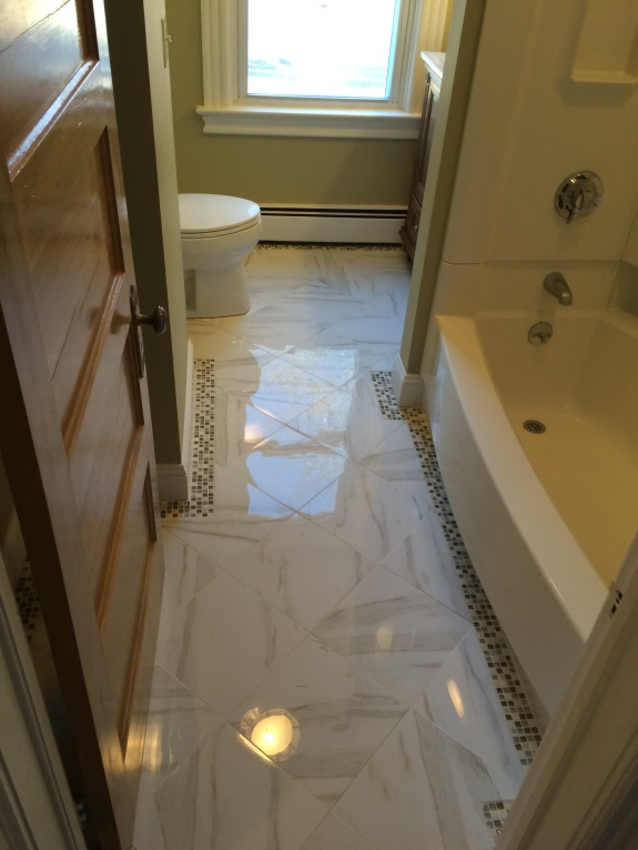 Second Floor Bath (After Renovations)- the old laminate floor was removed and a new tile floor was installed with a decorative border.