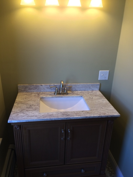 Second Floor Bath (After Renovations)- A new custom vanity and stone Vanity top was installed.